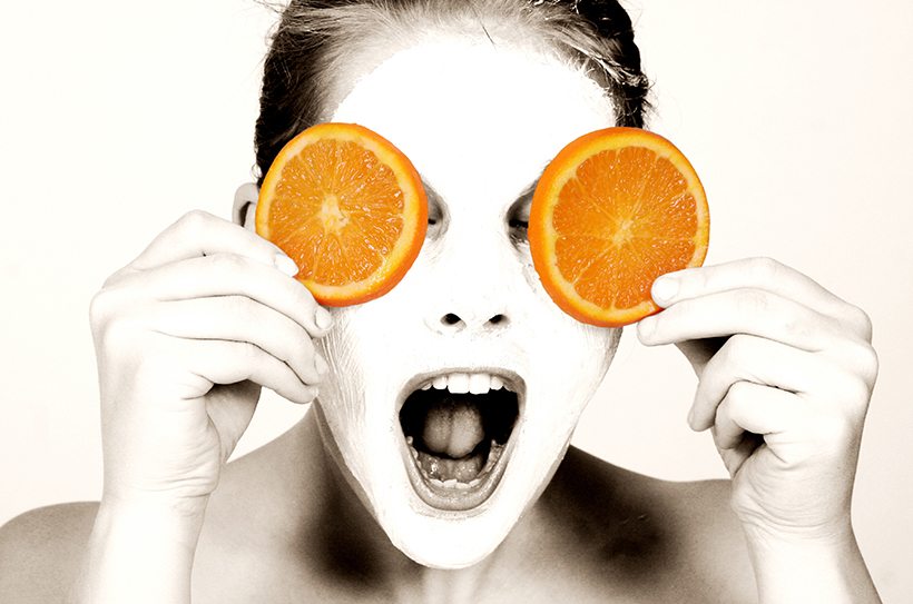 lady with slices of orange